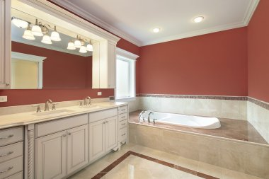 Master bath with salmon colored walls
