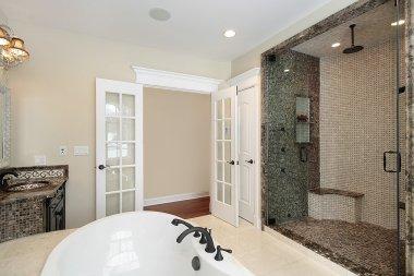 Master bath with tile shower