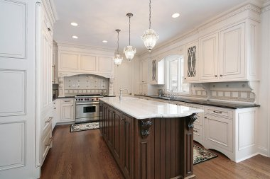 Kitchen with marble and wood island