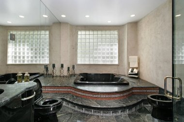 Master bath with black marble