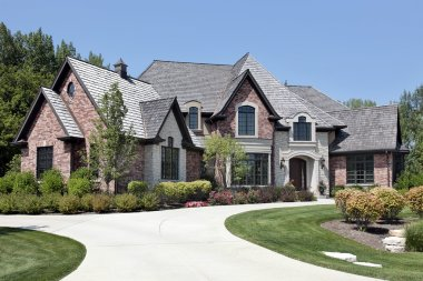 Large brick home with circular driveway