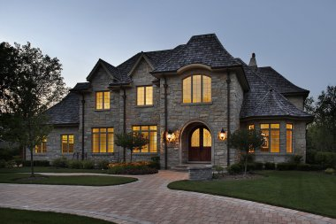 Luxury stone home at dusk