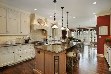 Kitchen with marble island countertop