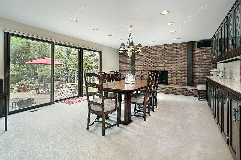 Dining Room With Brick Fireplace And View To Patio Photo By Lmphot
