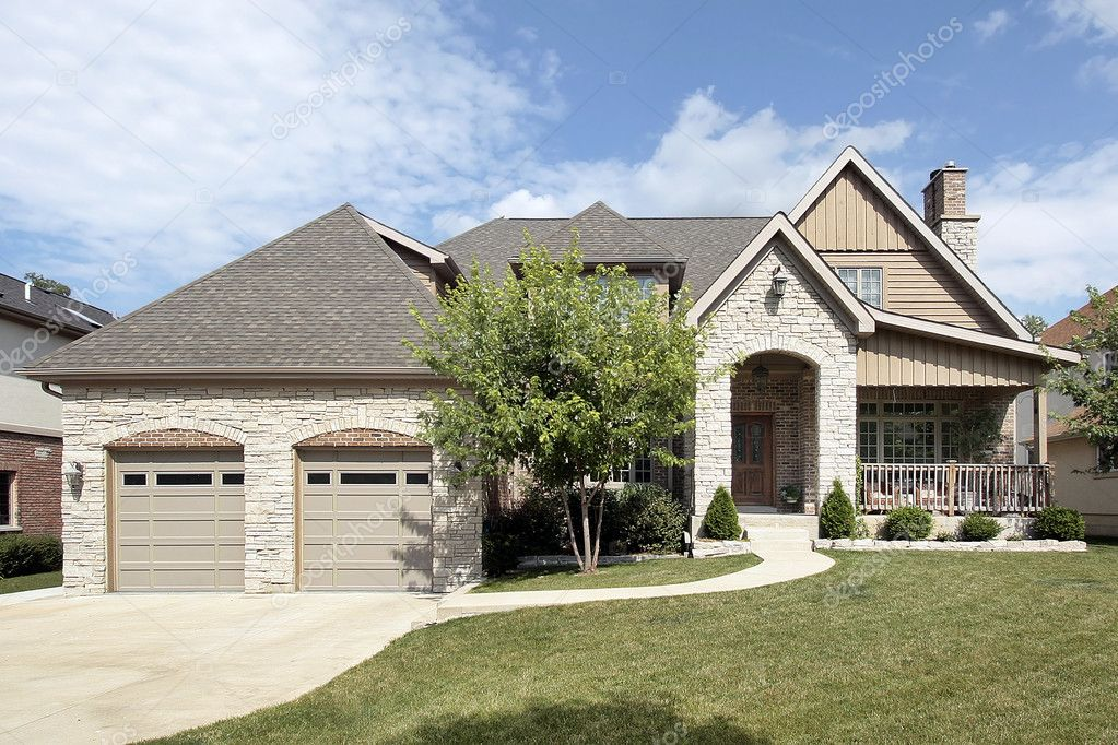 Luxury stone home with front porch