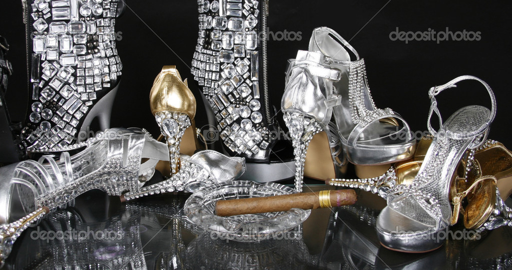 a8319185bc38a Jeweled Gold and Silver Shoes on a black background — Photo by Guzel