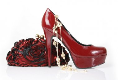 Red shoe, clutch bag and gold necklace