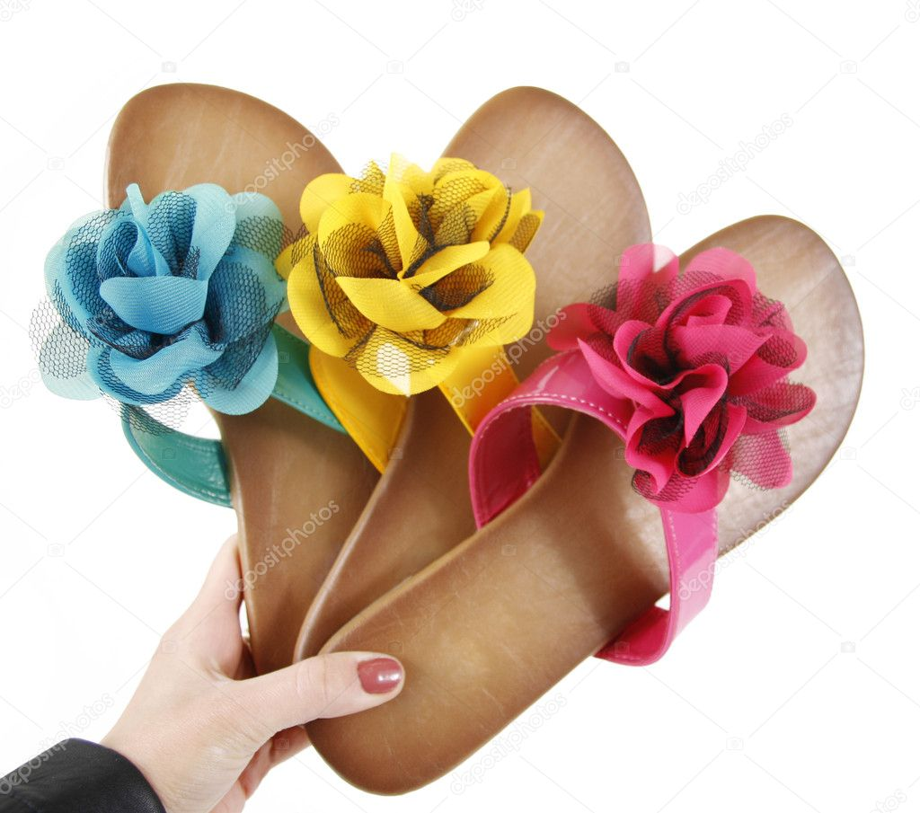 8933acdaf873 Colored flip-flops with flowers in hand — Stock Photo © Guzel  9117673