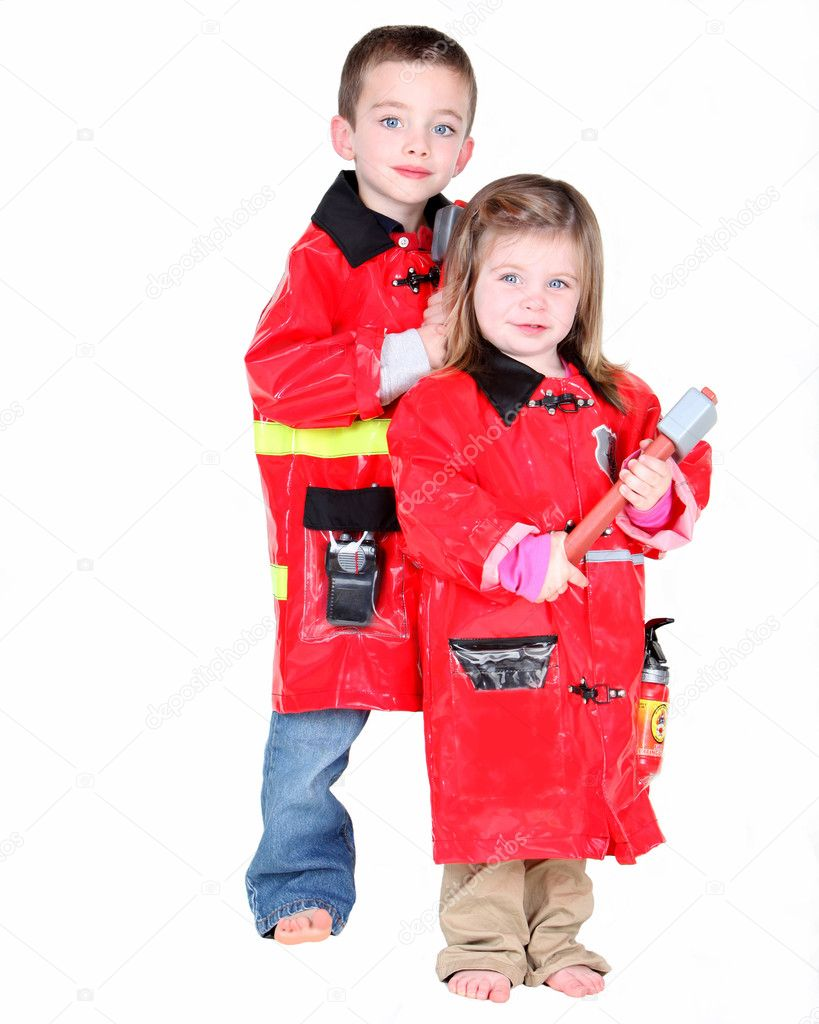 Two young children dressed as firemen