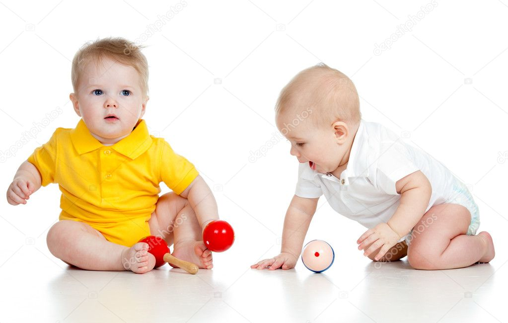 Little children with musical toys. Isolated on white background