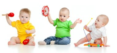 Children playing with musical toys. Isolated on white background