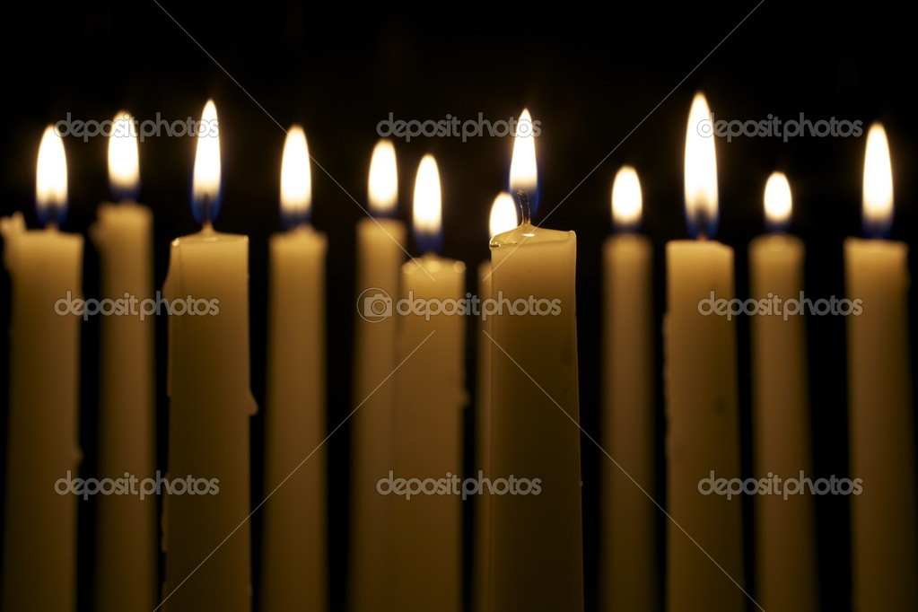 Several Candles on Black Background