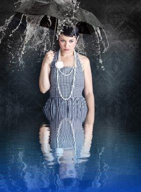 Beautiful gil with black umbrella in a depressed state in the wa