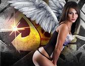krásná mladá žena s bílými křídly proti graffiti poz