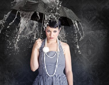 Beautiful girl with umbrella in a depressed state