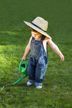 Sweet little baby gardener caught in the moment