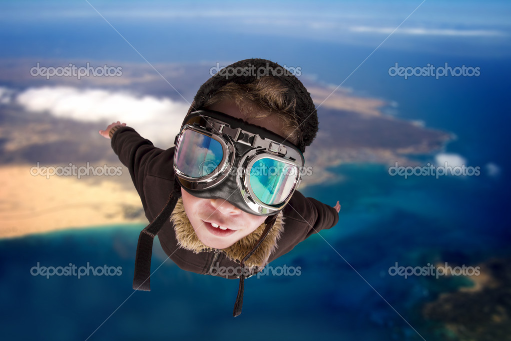 Boy flying, daydreaming he is a pilot