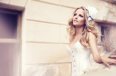 A beautiful bride in the white wedding dress