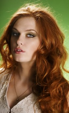 Portrait of young fresh beautiful girl with red curly hair