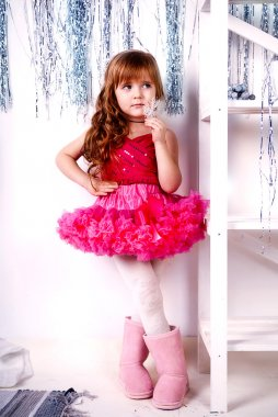 Portrait of an adorable preschool age girl playing dress up wearing a balle