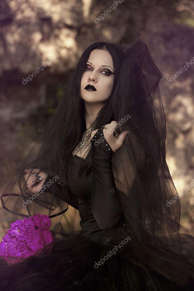 Beautiful gothic woman . Fashion.