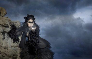 Fine art photos of glamor woman dressed as a crow