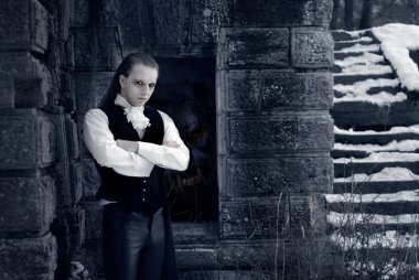 Portrait of a handsome young man with vampire style make-up.