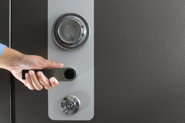 Hand opening a safe