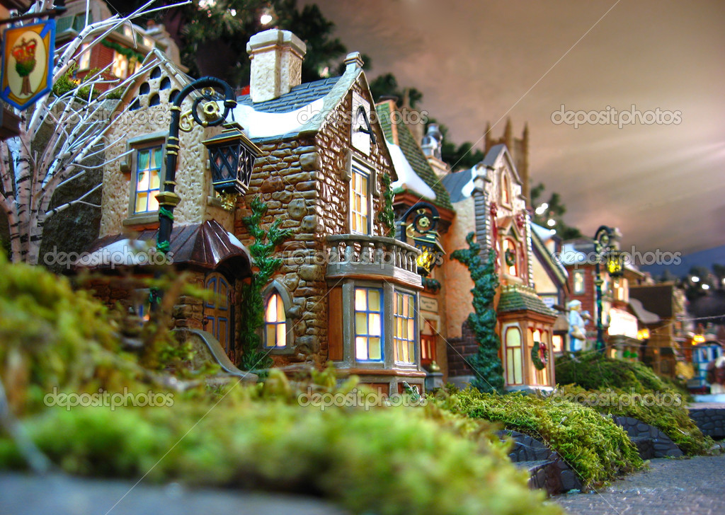 a traditional christmas decoration of christmas village miniatures photo by duckeesue