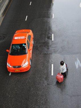 Bangkok July 2010.Old woman was walking across the street at Klong Toey, Bangkok Thailand