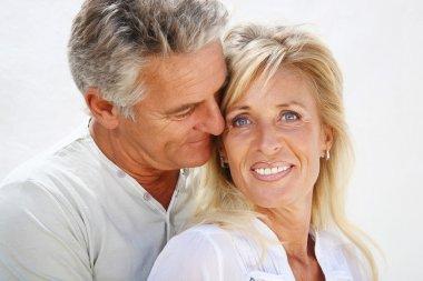 Happy mature couple smiling.