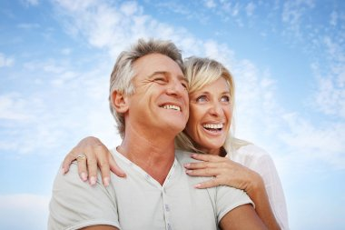 Closeup portrait of a happy mature couple having fun. stock vector