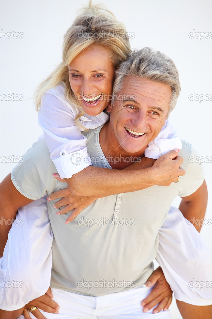 Happy mature couple having fun.