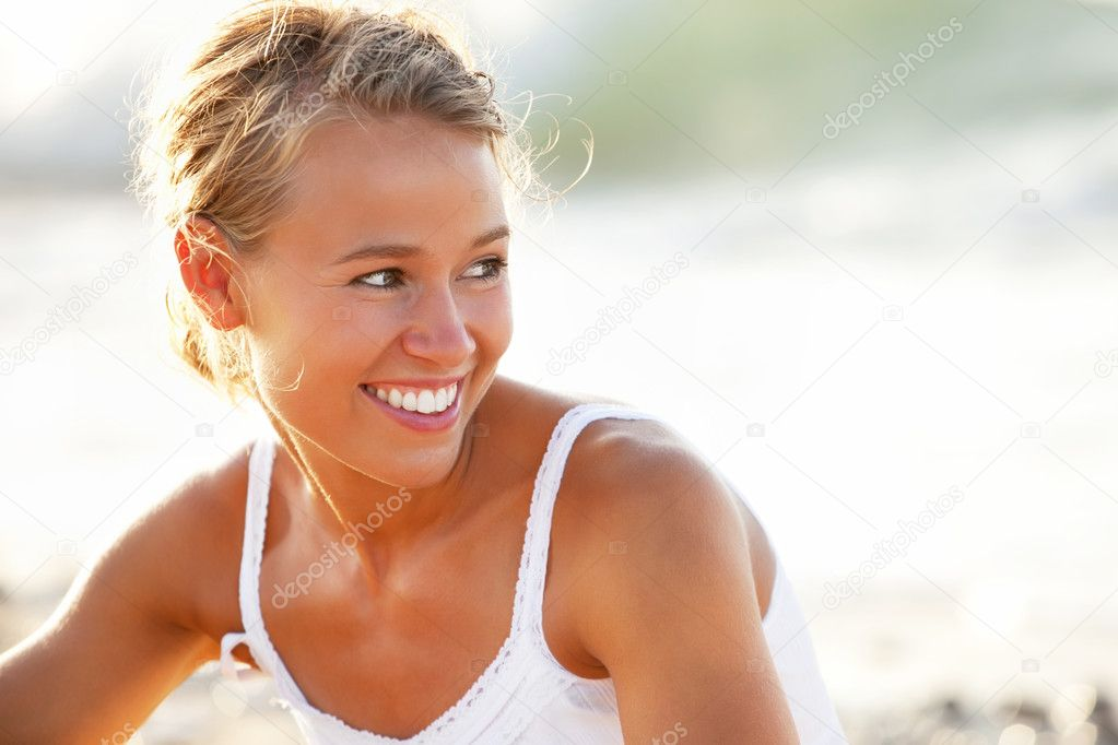 Beautiful young woman on the beach.