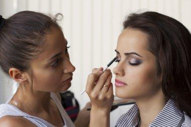 Makeup artist paints a model