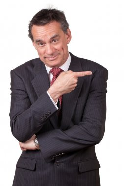 Smiling Business Man in Suit Pointing Right