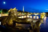 Alexander III bridge at night and Eiffel tower