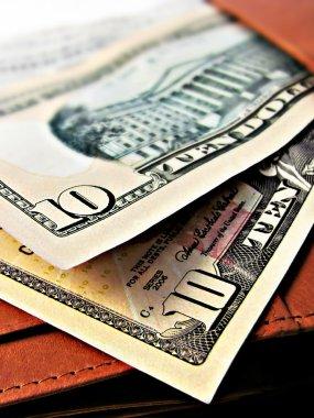Ten 10 dollar bills cash - on a wallet
