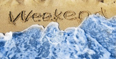 Weekend written in sand