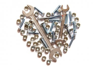 Assorted wrench,nuts and bolts heart on white background