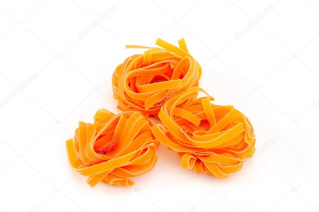 Colorful uncooked pasta - tagliatelle
