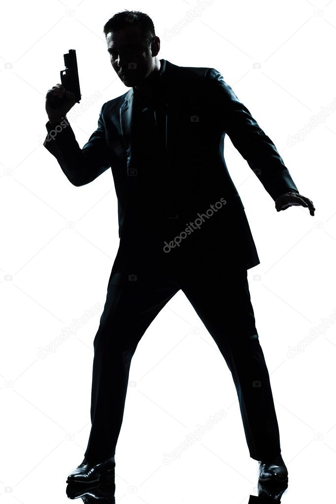 Silhouette Man Spy Holding Gun Stock Photo 169 Stylepics