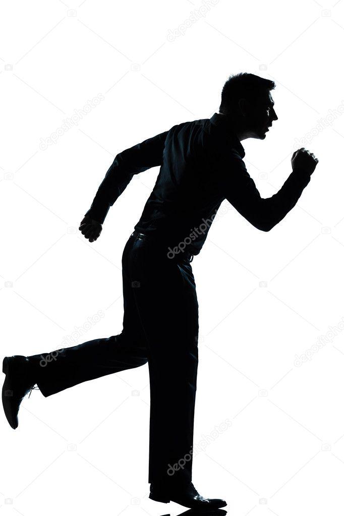 homem de negócios de silhueta correndo toda a extensão stock photo