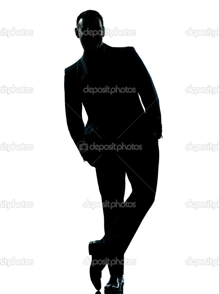 One business man standing Full length hands in pocket ...