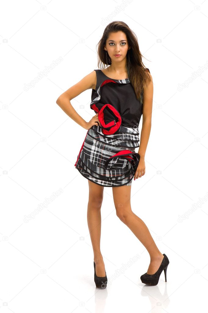 Portrait of a stunning young woman in designer short dress