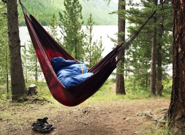Man sleeps in a hammock and in a sleeping