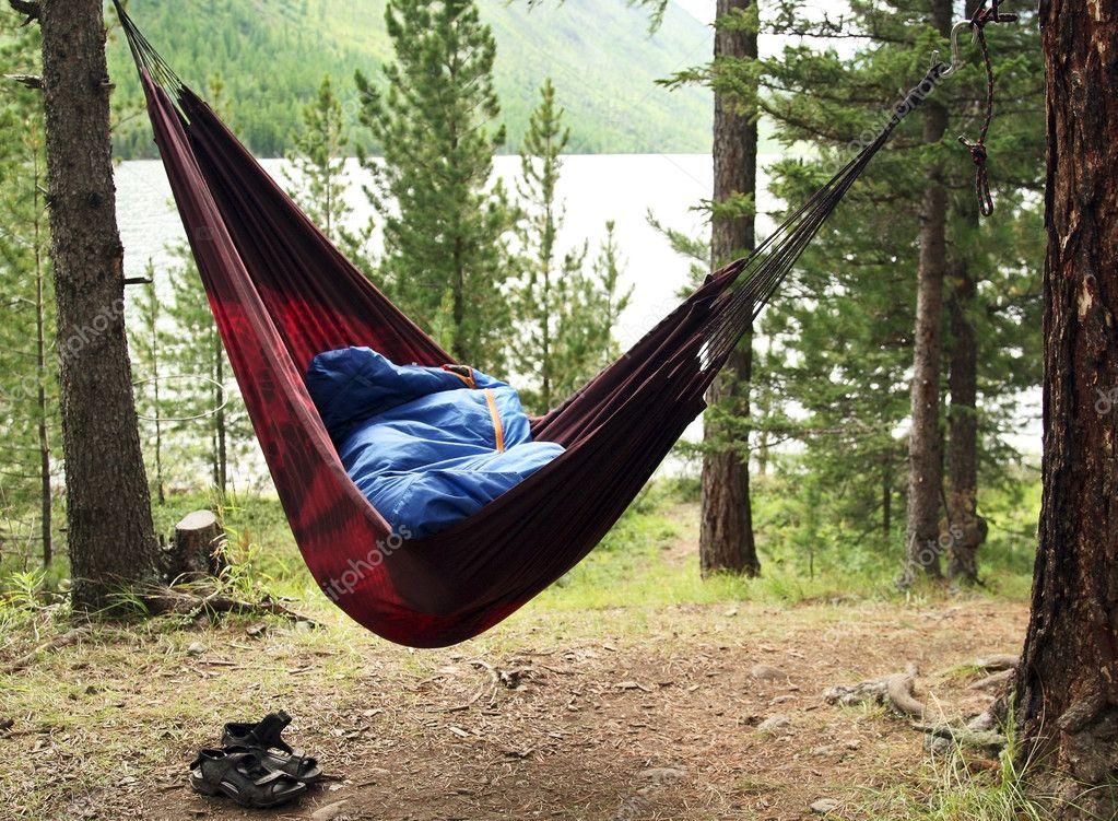 Man sleeps in a hammock and in a sleeping