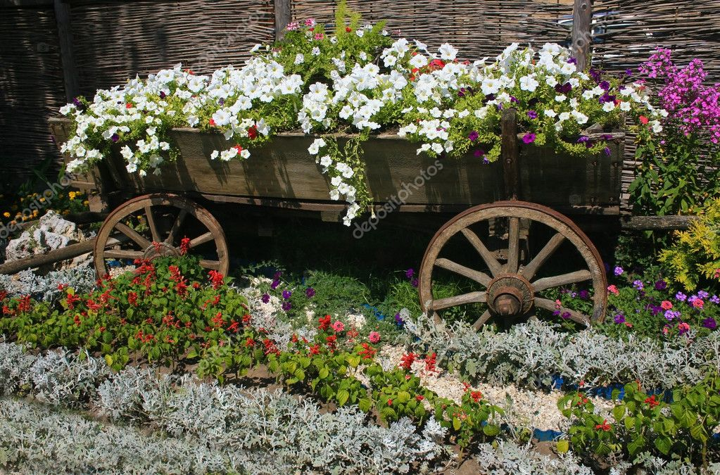 Bed with flowers issued old rural style
