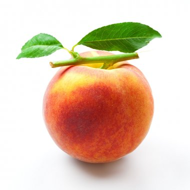Peach isolated. fruit with green leaves on white