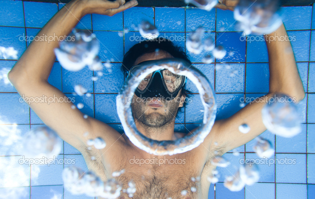 underwater man bubble picture in and pool rings making stock photo